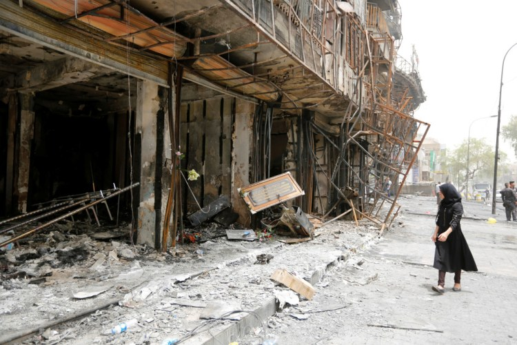 A girl walks past the site after a suicide car bomb attack at the shopping area of Karrada, a largely Shi'ite district, in Baghdad, Iraq July 4, 2016. Credit: REUTERS/Ahmed Saad