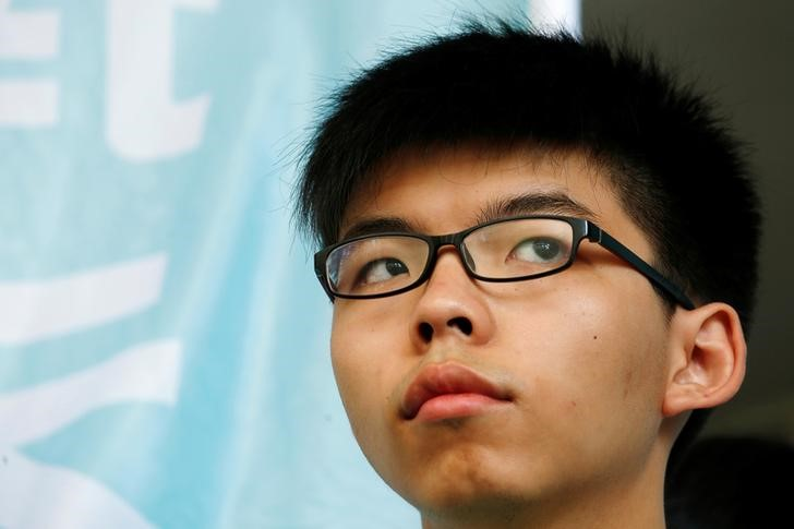 """Student leader Joshua Wong looks on before a verdict, on charges of inciting and participating in an illegal assembly in 2014 which led to the """"Occupy Central"""" pro-democracy movement, outside a court in Hong Kong July 21, 2016. Credit: REUTERS/Bobby Yip"""