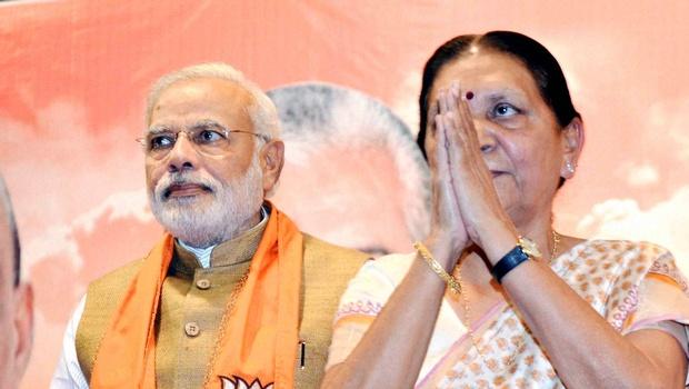 Outgoing chief minister of Gujarat Anandiben Patel with Prime Minister Narendra Modi. Credit: PTI