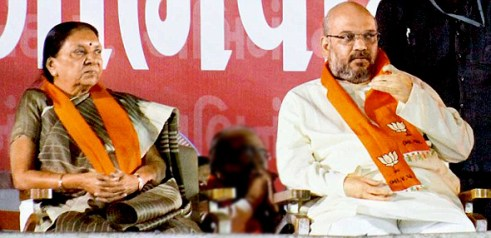 Outgoing chief minister of Gujarat Anandiben Patel with BJP President Amit Shah. Credit: anandibenpatel.com