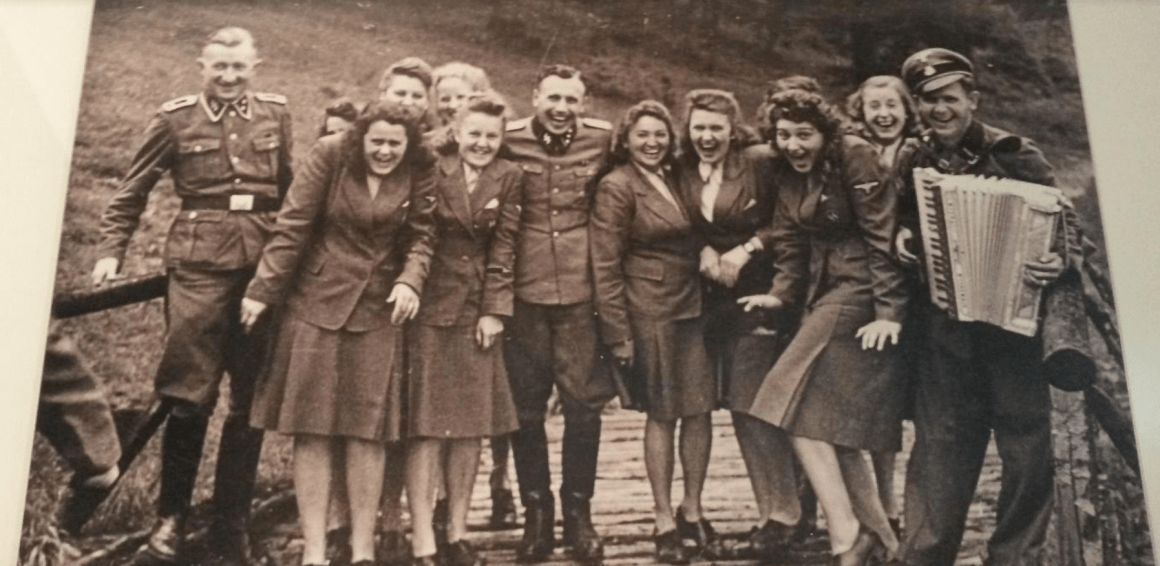 """Taking a break from mass murder… SS female auxiliaries ('SS maids') and SS men from Auschwitz concentration camp at the SS retreat Sola-Hutte, 30 kms south of the camp, in an idyllic mountain landscape. (Undated - probably July 22, 1944). At the center is Karl Hocker, adjutant to camp commandant Richard Baer."""