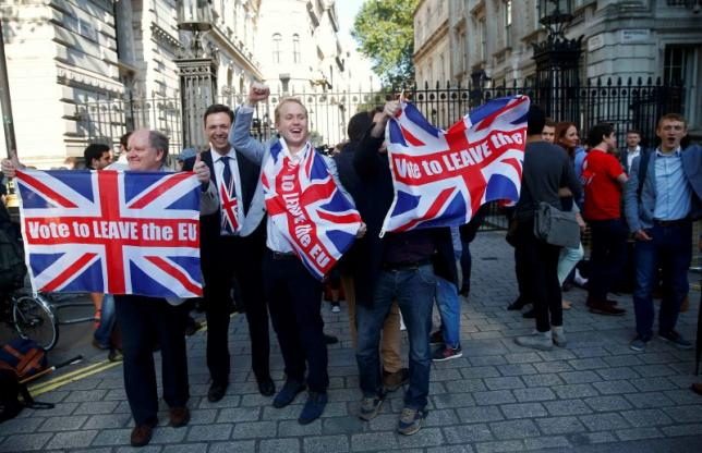 Vote Leave supporters wave Union flags, following the result of the EU referendum, outside Downing Street in London, Britain June 24, 2016. Credit: Reuters/Neil Hall/File Photo
