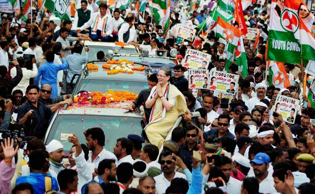 """Congress President Sonia Gandhi started her campaign for the UP polls with a road show in Varanasi. Credit"""" PTI"""