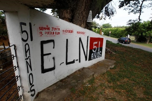 A graffiti, of rebel group Army Liberation National (ELN) is seen at the entrance of the cemetery of El Palo, Cauca, Colombia, February 10, 2016. Credit: Reuters/Jaime Saldarriaga/Files