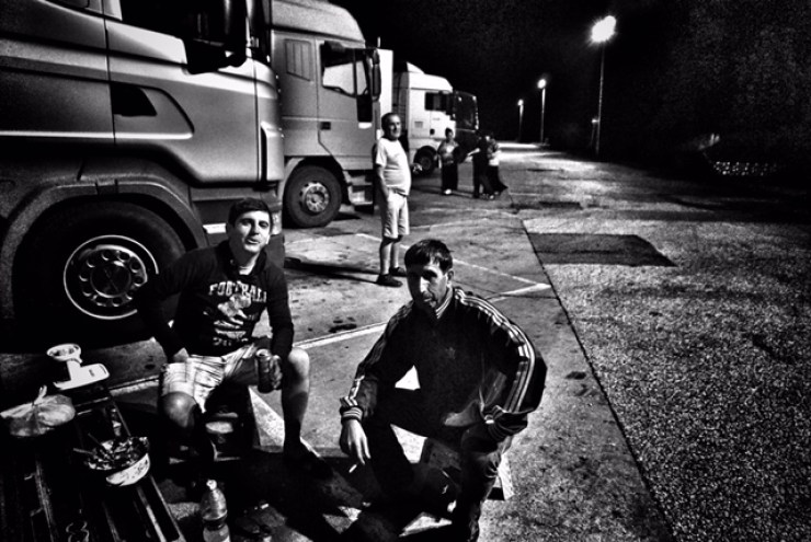 Alexander with his fellow truckers hit a motel for dinner and beer just after crossing the Serbian checkpoint. Credit: Shome Basu