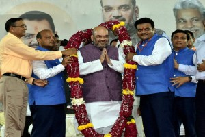 BJP president Amit Shah being garlanded at a function in Surat on Thursday. Credit: PTI