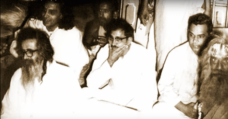 Deendayal Upadhaya, seated between a young Atal Bihari Vajpayee and the older M.S. Golwalkar, head of the RSS. Credit: YouTube screenshot from Jeevan Darshan.