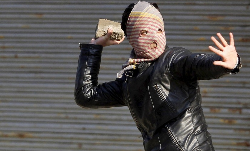 File photo of a A Kashmiri demonstrator throwing a stone towards Indian police (unseen) during a protest in Srinagar . Credit: reuters
