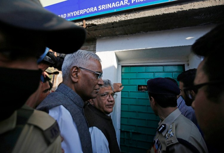 Communist MP's Sitaram Yechury and D. Raja waiting out side the door of Hurriyat leader Syed Ali Shah Geelani in Srinagar on Sunday. Sitaram Yechury and D Raja are part of the all party delegation visiting Kashmir but the separatist leaders refuse to meet them. Credit: PTI/S. Irfan