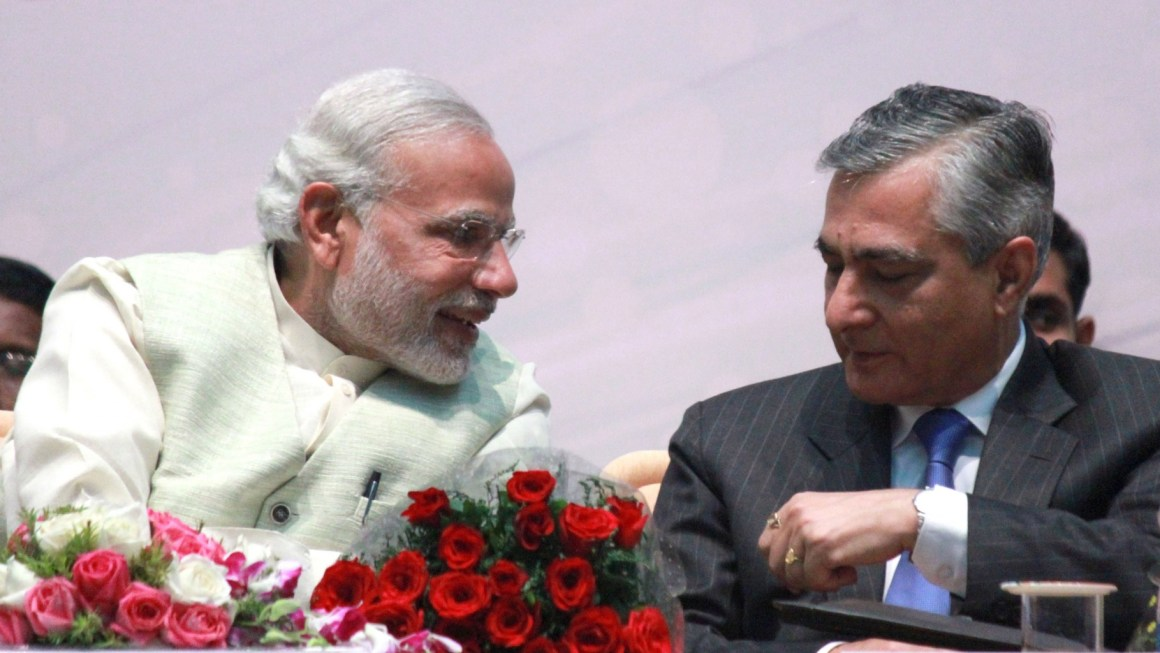 File photo of Prime Minister Narendra Modi and Chief Justice T.S. Thalur. Credit: IANS