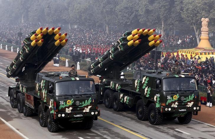 Indian army officers stand on vehicles displaying missiles during the Republic Day parade. Credit: Reuters