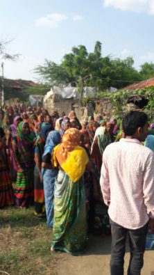 Villagers gather in front of Prabhatbhai's residence after his death. Credit: Damayantee Dhar