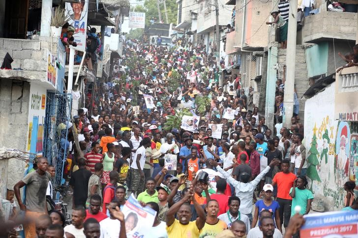 Supporters of Fanmi Lavalas political party march to claim the victory of their candidate in the streets of Port-au-Prince, Haiti, November 27, 2016. REUTERS/Jeanty Junior Augustin