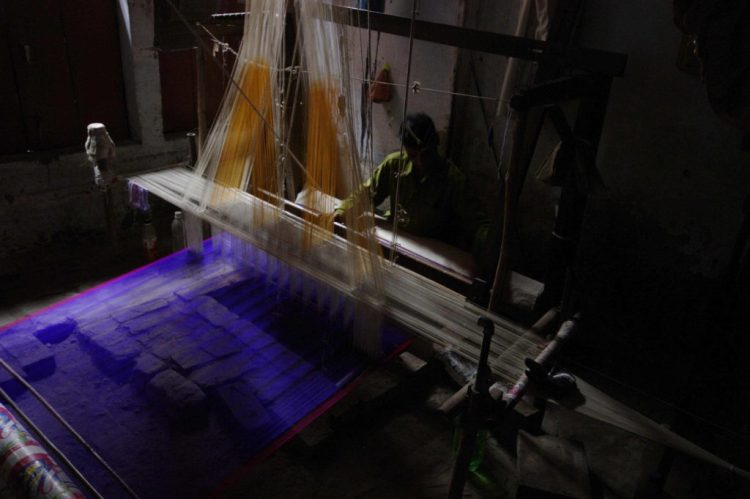 Representational image of a silk weaver in Varanasi. Credit: Andrea Kirby/ Flickr, CC BY-NC 2.0