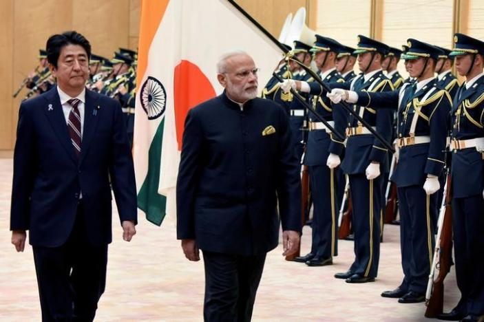 Indian Prime Minister Narendra Modi (2nd L) and his Japanese counterpart Shinzo Abe (L). Credit: Reuters