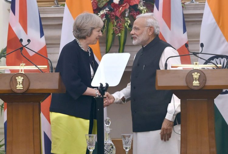 Prime Minister Narendra Modi and British Prime Minister Theresa May shake hands during the joint statement at Hyderabad House in New Delhi on Monday. Credit: PTI/Shahbaz Khan