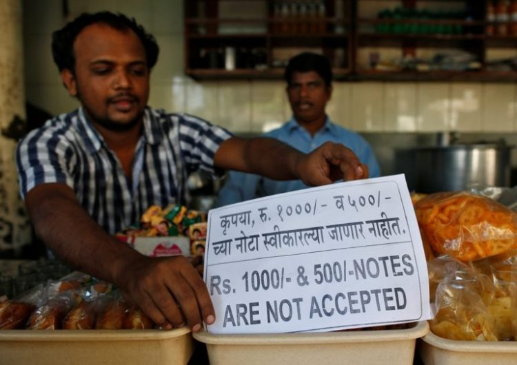 A man puts a notice inside his eatery in Mumbai, India, November 9, 2016. Credit: Reuters