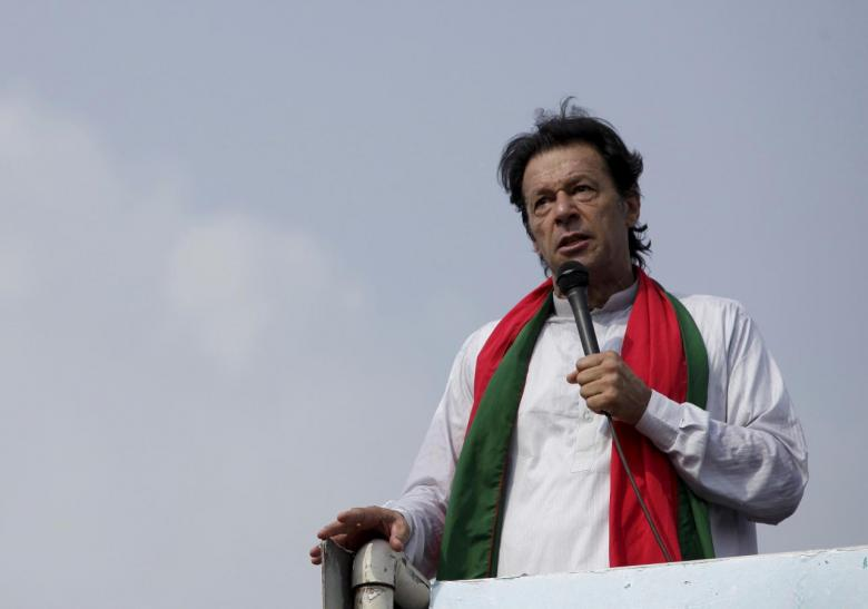 "Chairman of the Pakistan Tehreek-e-Insaf (PTI) political party Imran Khan addresses his supporters during what has been dubbed a ""freedom march"" in Islamabad August 21, 2014. Credit:Reuters/Faisal Mahmood/Files"