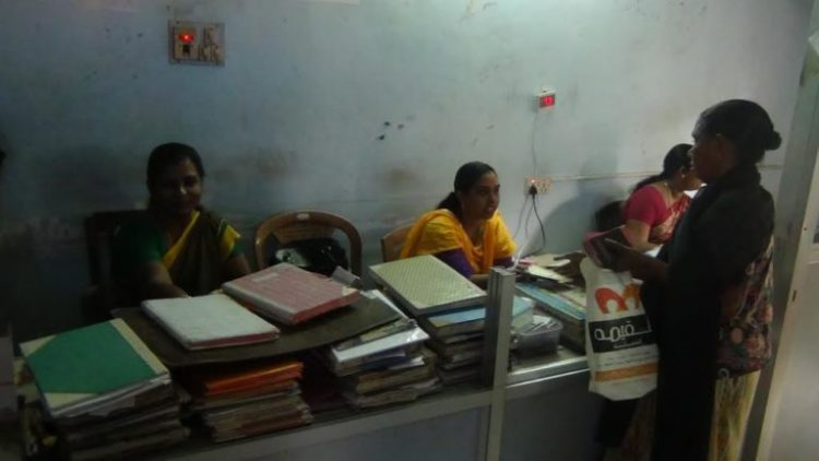 A primary corporative society in Anchu Thengue village where the staff are trying to pacify an account holder. Credit: K. Rajendran