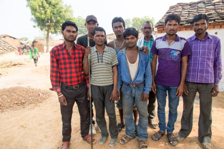A group of migrant labourers, who work seasonally in various states across North India, recently returned to their village in Tikamgarh district, Madhya Pradesh as they were unable to find work or receive their salaries in the form of cash payments. Credit: Hina Fathima