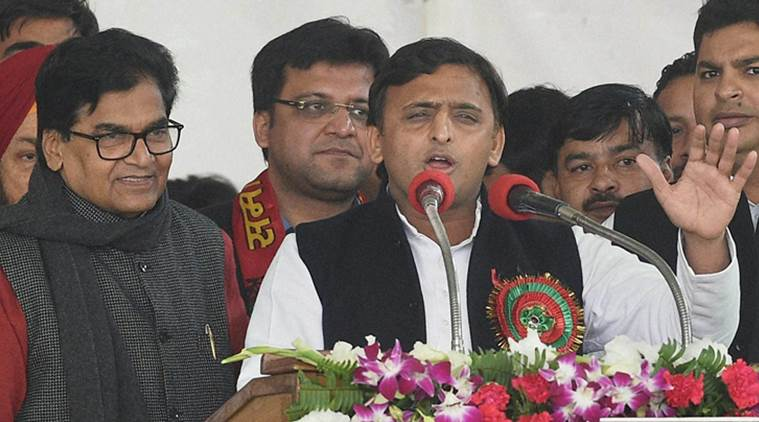 Uttar Pradesh chief minister and newly elected national president of the Samajwadi Party Akhilesh Yadav speaks as SP general secretary Ram Gopal Yadav looks on during the Samajwadi party national convention in Lucknow on Sunday. Credit: PTI/Nand Kumar