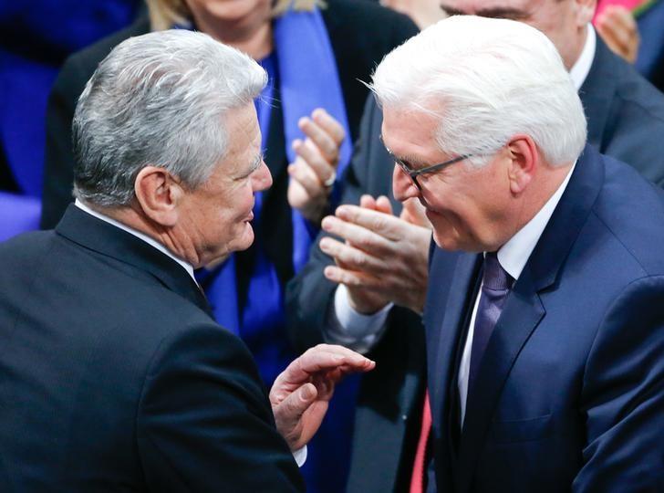 German president-elect, Frank-Walter Steinmeier receives congratulations by hi predecessor Joachim Gauck after the first round of voting of the German presidential election at the Reichstag in Berlin, February 12, 2017. Credit: Reuters/Hannibal Hanschke