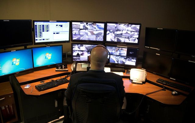 A telecommunications operator looks at video from different US-Canada border spots allowed to be shown to the media during a Royal Canadian Mounted Police tour of their facilities in Montreal, Quebec Canada February 20, 2017. Credit: Reuters