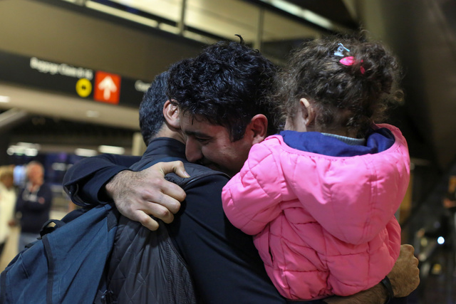 Iranian citizen and U.S green card holder Cyrus Khosravi (C) greets his brother, Hamidreza Khosravi (L), and niece, Dena Khosravi (R), 2, after they were detained for additional screening following their arrival to Seattle-Tacoma International Airport to visit Cyrus, during a pause in U.S. President Donald Trump's travel ban in SeaTac, Washington, U.S. February 6, 2017. REUTERS/David Ryder