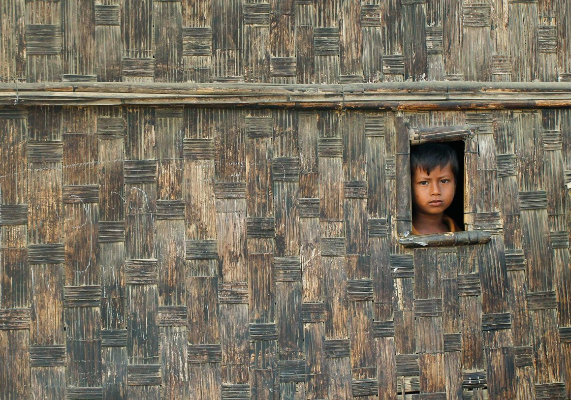 Representative image: A boy looks from his temporary shelter at a Rohingya refugee camp. Credit: Reuters/Soe Zeya Tun