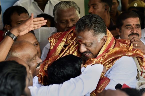Chennai: Tamil Nadu Chief Minister O Panneerselvam being greeted by AIADMK founding leader and former speaker of the state Assembly PH Pandian at his residence in Chennai on Wednesday. PTI Photo by R Senthil Kumar (PTI2_8_2017_000063A)