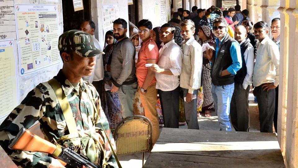 Voters wait in a queue to cast votes during the first phase of UP Assembly elections in Mathura on Saturday. Credit: PTI