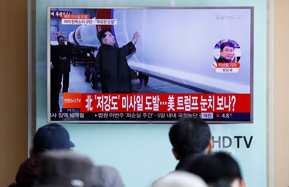 Onlookers in Seoul, South Korea, watch news of another North Korean ballistic missile test. Credit: Kim Hong-Ji/Reuters