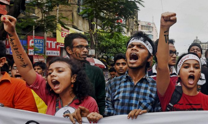 Kolkata: Students take part in a rally aganist the alleged molestation of Jadavpur University female student in Kolkata on Friday. PTI Photo by Ashok Bhaumik(PTI9_19_2014_000199B) *** Local Caption ***