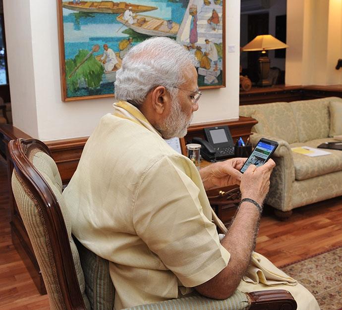 The prime minister using his phone. Credit: www.narendramodi.in