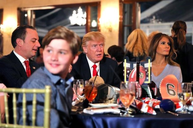 US President Donald Trump and First Lady Melania watch the Super Bowl LI between New England Patriots and Atlanta Falcons, accompanied by White House Chief of Staff Reince Priebus (L) at Trump International Golf club in West Palm Beach, Florida, US., February 5, 2017. Credit: Reuters