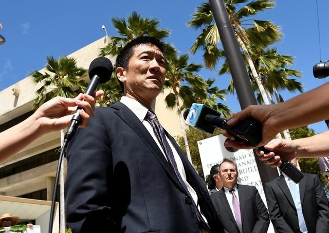 Hawaii attorney general Douglas Chin talks to the media at the US district court Ninth Circuit after seeking an extension after filing an amended lawsuit against President Donald Trump's new travel ban in Honolulu, Hawaii, March 29, 2017. Credit: Reuters