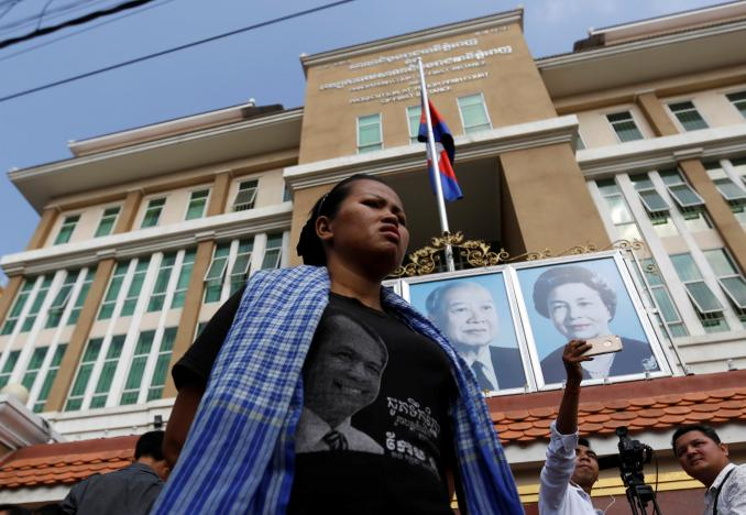 "A supporter of Cambodia's late anti-government figure and the head of a grassroots advocacy group, ""Khmer for Khmer"" Kem Ley stands outside the court building in Phnom Penh, Cambodia March 23, 2017. Credit: Reuters"