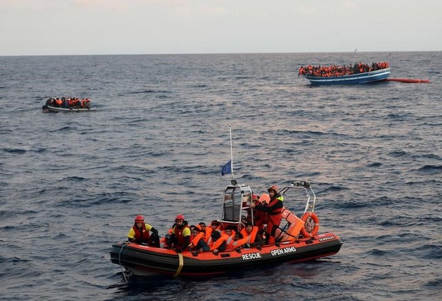 Over 400 migrants are seen overcrowding a wooden vessel drifting in central Mediterranean Sea off the Libyan coast, March 29, 2017 during a search and rescue operation by Spanish NGO Proactiva Open Arms. Credit: Reuters