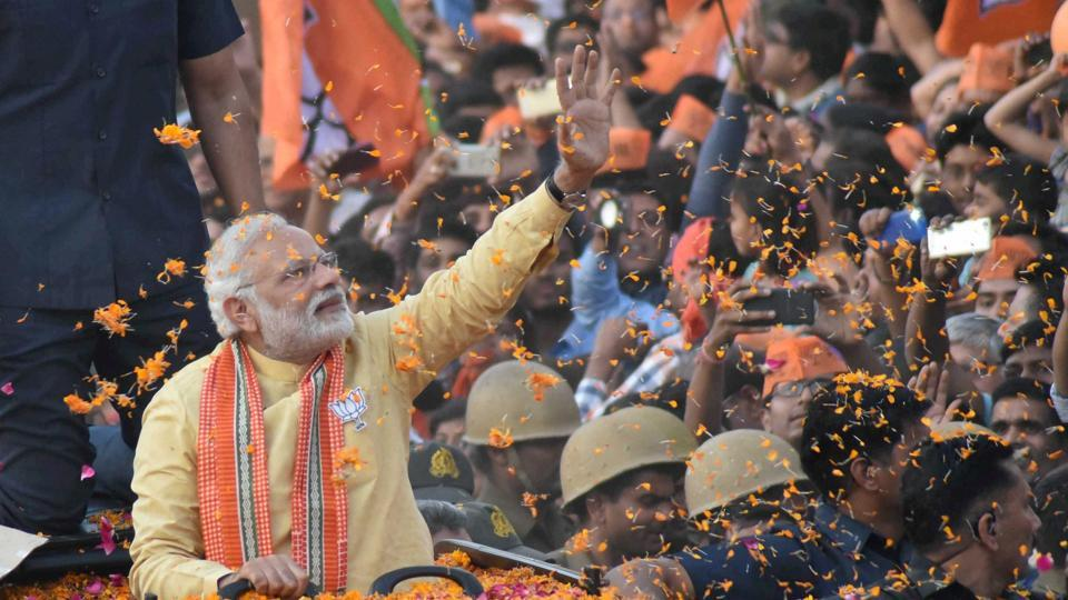 Prime Minister Narendra Modi during his roadshow in Varanasi on Sunday, March 5. Credit: PTI