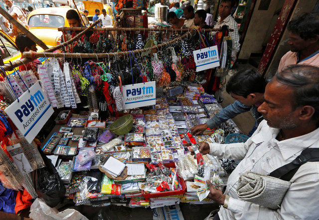 Advertisements of Paytm, a digital wallet company, are seen placed at a road side stall in Kolkata, India, January 25, 2017. Picture taken January 25, 2017. Credit: Reuters