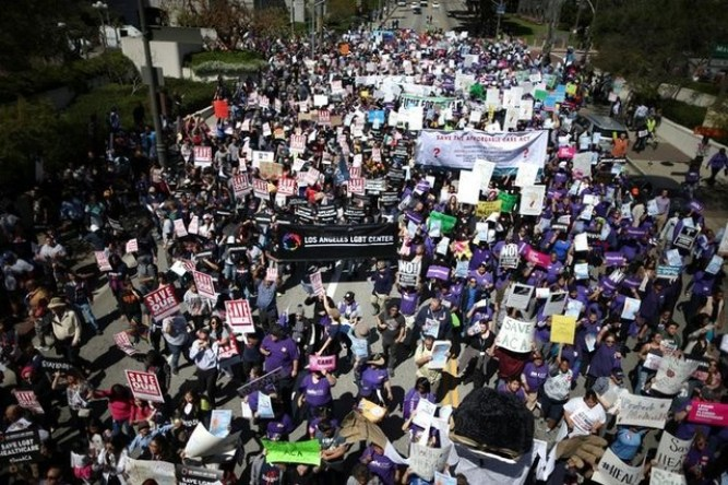 "People march in a ""Save Obamacare"" rally on the seventh anniversary of Obamacare's signing, in Los Angeles, California, US March 23, 2017. Credit: Reuters"