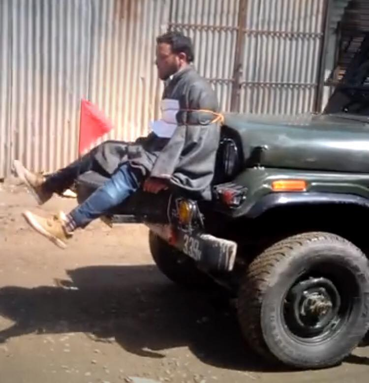 An unidentified Kashmir man strapped to the front of a jeep carrying security personnel in Beerwah, Jammu and Kashmir. Credit: Junaid Azim Mattoo/Twitter