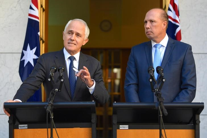 Australia's Prime Minister Malcolm Turnbull speaks as immigration minister Peter Dutton listens on during a media conference at Parliament House in Canberra, Australia, April 18, 2017. Credit: Reuters/AAP/Lukas Coch