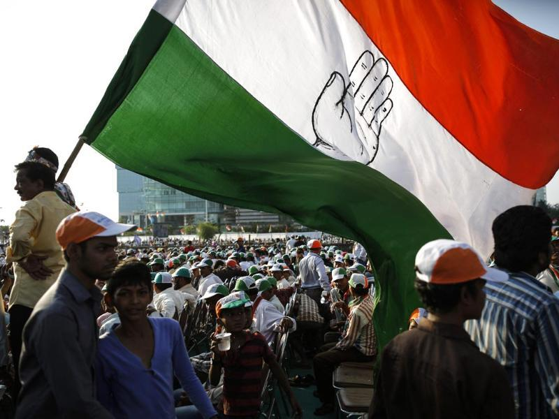 Congress supporters wave a party flag. Credit: Reuters