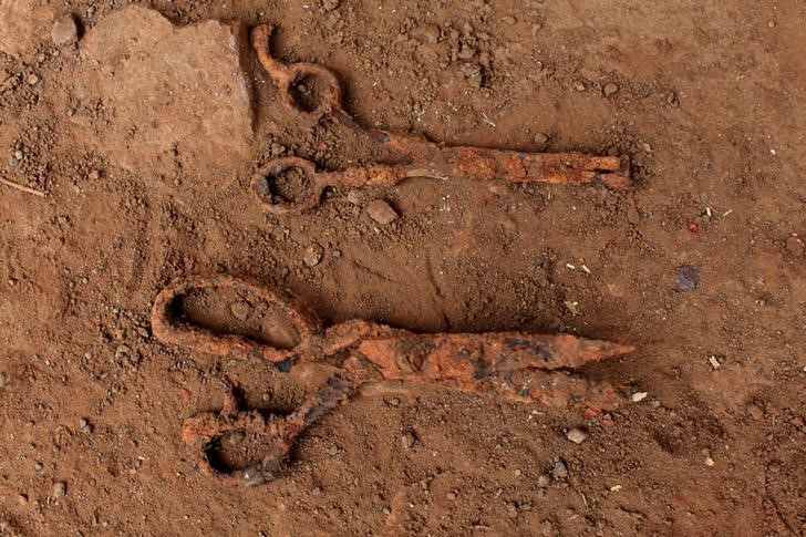 Scissors found at an exhumation site are photographed in the village of El Mozote, Meanguera, El Salvador, March 30, 2017. Credit: Reuters/Jose Cabezas