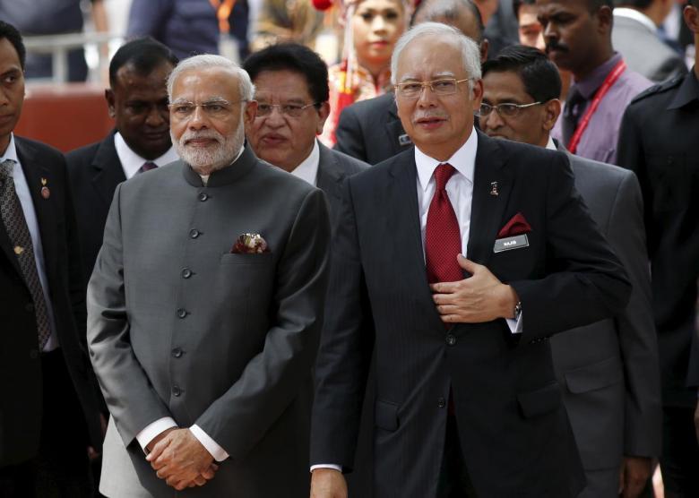 India's Prime Minister Narendra Modi (L) and Malaysia's Prime Minister Najib Razak attend the opening of the Torana Gate, in an Indian suburb of Kuala Lumpur, Malaysia, November 23, 2015. REUTERS/Olivia Harris