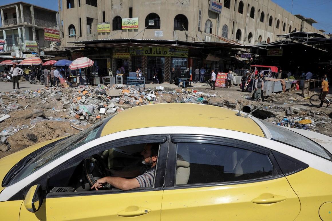 A man drives a car past a market in eastern Mosul, Iraq, April 19, 2017. Credit: Reuters/Marko Djurica
