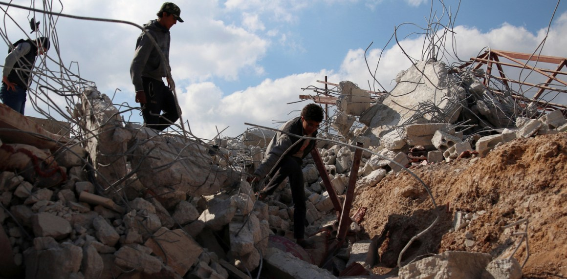Youth inspect rubble of a damaged house after an airstrike yesterday on rebel-held Daraa Al-Balad, Syria April 7, 2017. Credit: REUTERS/Alaa Al-Faqir - RTX34MLB