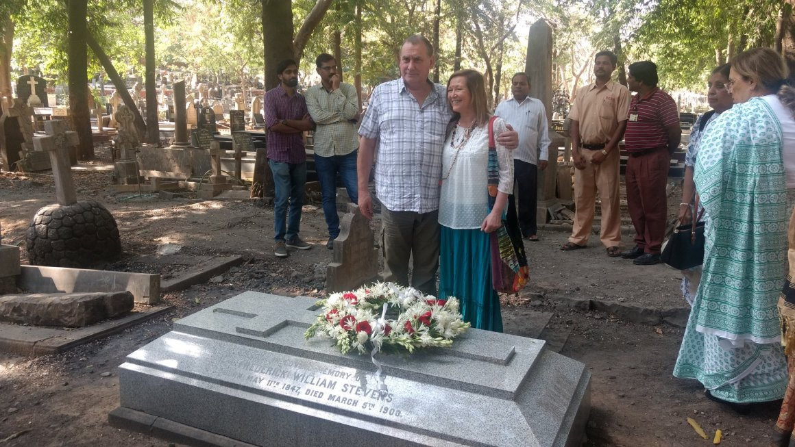 Diana Robertson and her husband Kevin at the grave of her great grandfather, the architect F W Stevens, in Mumbai. Credit: Rajendra B Aklekar