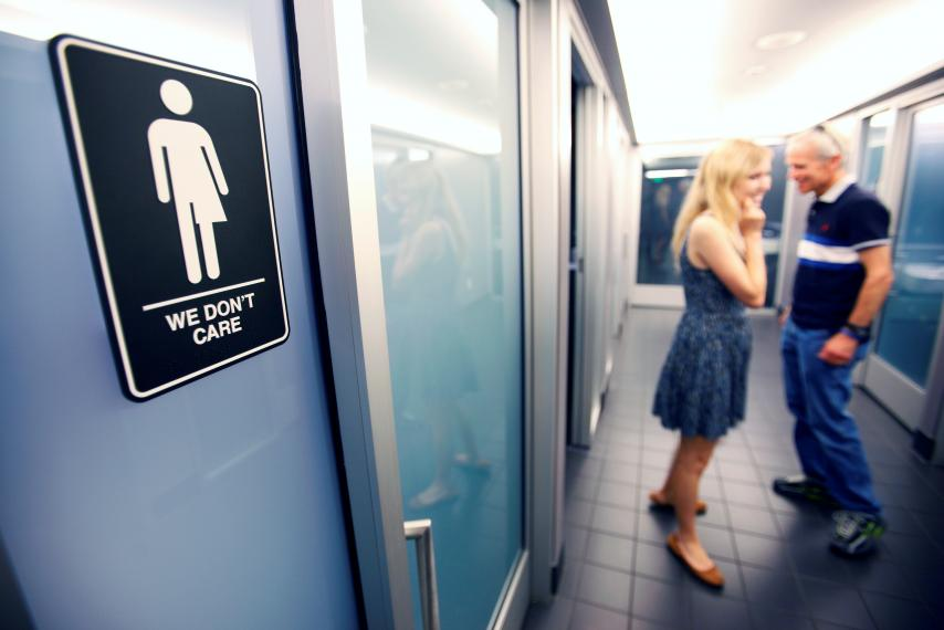 A sign protesting the former North Carolina law restricting transgender bathroom access. Credit: Reuters/Jonathan Drake